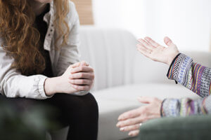 A therapist discusses counseling techniques with a client